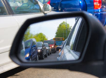 Reflection in the mirror of a car. Congestion Stock Images