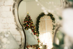In the reflection mirror Christmas tree Stock Photos