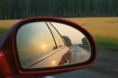 Reflection in mirror of moving car Royalty Free Stock Images