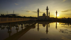 Reflection of a modern beautiful mosque during blue hour sunrise Stock Images