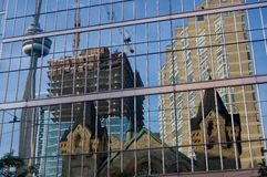 Reflection of modern building. Reflection of constraction,cn-tower,church and modern building in the same time stock photo