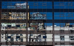 The reflection of modern houses in a glass building. In Moscow in summer Stock Image