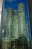 Reflection of a skyscraper in the windows of another highrise tower at La Defense busines district, paris, france. Reflection of modern skyscraper mirrored in royalty free stock photos