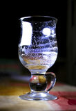 Reflection of the moon. The reflection of the moon in empty glass on a dark background stock photo
