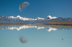 Reflection of Moon, Mt. Cook & lake Pukaki Stock Image