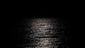 Reflection of the moon in seawater, a long path of moonlight reflected in the water.  stock video