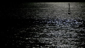 Reflection of moonlight sea with a lighted buoy. stock video