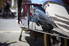 Reflection of moped on hood of another moped. Stock Photos