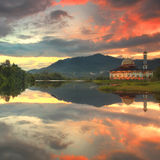 Reflection of a mosque by the lake with beautiful sunrise Royalty Free Stock Photos