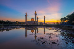 A Reflection of a Mosque at Sunrise Royalty Free Stock Images
