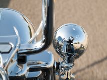 Reflection of motorcyclist in the spotlight royalty free stock images