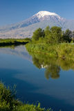 Reflection of the Mount of Ararat and blue sky in the Sev Jur Ri Stock Photos