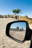 Reflection of the mountain with an ancient dwelling in the car m. Irror. Cappadocia Royalty Free Stock Image