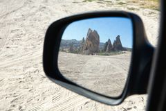 Reflection of the mountain with an ancient dwelling in the car m. Irror. Cappadocia Stock Image