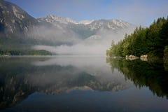 Reflection the mountain in lake Bohinjsko Jezero. Triglav National Park, Slovenia Royalty Free Stock Photos