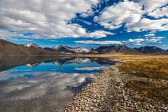 Reflection in mountain lake, Chukotka, Russia royalty free stock images