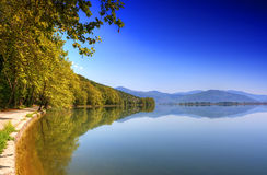 Reflection mountain into the lake (Makedonia,Greec. E)  with blue sky Royalty Free Stock Photos