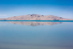 Reflection of the mountain in a lake in Tibet Royalty Free Stock Images
