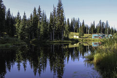 Reflection mountain pond. Silverstar pond summertime reflections mountain resort Stock Images
