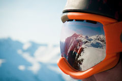 Reflection. A mountain range reflected in the ski mask Stock Photo