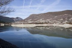Reflection of the mountain in the reservoir of Arguis. Huesca Stock Photos