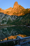 Reflection of a mountain at sunrise Stock Images