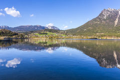 Reflection of mountain village in Hallstatter See, Austria, Euro Royalty Free Stock Photo
