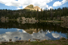 Reflection of the mountains behind Island Lake in Utah. Reflection of the mountains in Island Lake located in the High Uintas Royalty Free Stock Photography