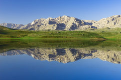 Reflection of the mountains, enjoying the landscape and insatiable Stock Images
