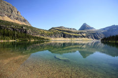 Reflection of the Mountains in Hidden Lake, Glacier National Par Stock Photo