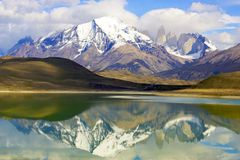 Reflection of mountains in a lake. The torres del paine mountain peaks mirrored in the lake below on a windstill moment Stock Photo
