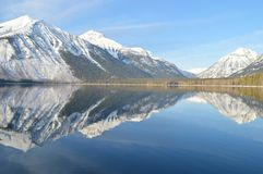 Reflection of Mountains in Lake Against Sky royalty free stock photography