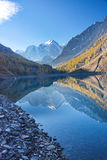 Reflection of mountains in the lake in the autumn morning Stock Images