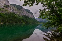 Reflection with mountains by the lake royalty free stock photo