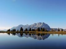 Reflection of Mountains in Lake - Schlosserbergsee Tirol. Perfekt reflection of Wilder Kaiser Massive (Tirol) in Mountain Lake Stock Photography