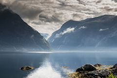 Eidfjord norway. Reflection of mountains and nature in eidfjord norway Royalty Free Stock Photo