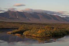 Reflection of mountains in the river. Polar Urals. Sob River. Mountain range Rai-Iz. Russia royalty free stock photography