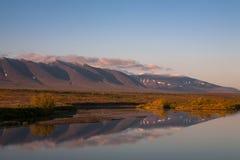 Reflection of mountains in the river. Polar Urals. Sob River. Mountain range Rai-Iz. Russia royalty free stock image