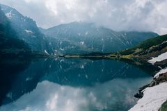 Reflection of mountains in sky water of Czarny Staw pond, Tatra Mountains, Poland. Reflection of mountains in water of Czarny Staw pond, Tatra Mountains, Poland royalty free stock photo