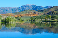 Reflection of mountains and trees Stock Photography