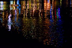 Reflection of colored lights in water stock images