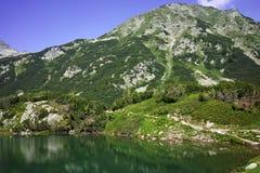 Reflection of Muratov peak in Okoto lake, Pirin Mountain Royalty Free Stock Images