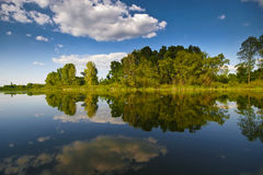 Reflection in Nature. Reflection of nature and beautiful clouds Royalty Free Stock Images