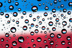 Reflection of Netherlands flag. On water droplet Royalty Free Stock Images