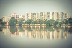 Reflection of new estate HDB housing complex on Jurong Lake, Sin. Reflection of new estate HDB housing complex on Jurong Lake neighborhood in Singapore at Royalty Free Stock Images
