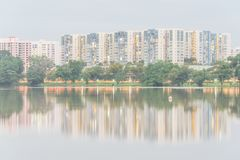 Reflection of new estate HDB housing complex on Jurong Lake, Sin. Reflection of new estate HDB housing complex on Jurong Lake neighborhood in Singapore at Royalty Free Stock Photo