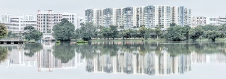 Reflection of new estate HDB housing complex on Jurong Lake, Sin. Panorama reflection of new estate HDB housing complex on Jurong Lake neighborhood in Singapore Royalty Free Stock Photography