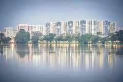 Reflection of new estate HDB housing complex on Jurong Lake, Sin. Reflection of new estate HDB housing complex on Jurong Lake neighborhood in Singapore at Stock Photos