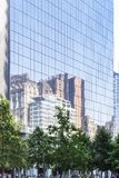 Reflection of the New York Skyline in the Windows of Four World Trade Center in New York, USA. Reflection of the New York city Skyline in the Windows of Four royalty free stock photo