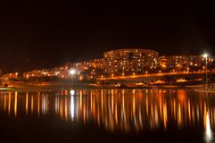 Reflection of the night city in the lake Modiin Israel. NThe night city will be reflected in the lake, Modiin, Israel stock photo